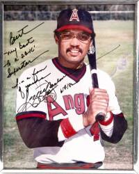 REGGIE JACKSON SIGNED AND INSCRIBED PHOTOGRAPH TO BURT REYNOLDS