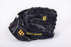 BURT REYNOLDS MATT MORRIS GAME USED AND SIGNED BASEBALL GLOVE