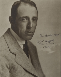 D.W. GRIFFITH PHOTOGRAPH SIGNED TO HAROLD LLOYD