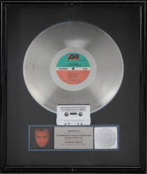 "PHIL COLLINS ""PLATINUM"" RECORD AWARD"