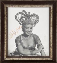 BETTY GRABLE SIGNED BLACK AND WHITE PHOTOGRAPH