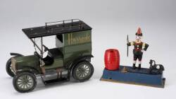 HARRODS TOY CAR AND TRICK DOG BANK