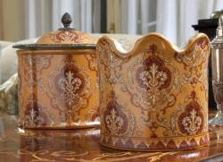 TWO ORANGE PORCELAIN TABLETOP CONTAINERS, ONE LIDDED