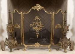 GILDED FIRESCREEN AND PAIR OF URN SHAPED ANDIRONS