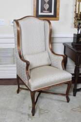 PAIR OF UPHOLSTERED WINGBACK CHAIRS