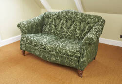 A VICTORIAN STYLE TWO SEATER SOFA