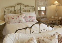 A VICTORIAN STYLE WROUGHT IRON DOUBLE BED
