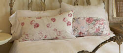 TWO FLORAL CHINTZ PILLOWS