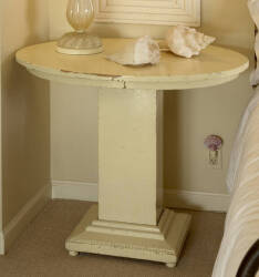 A SIDE TABLE WITH OVAL TOP AND RECTANGULAR PEDEST