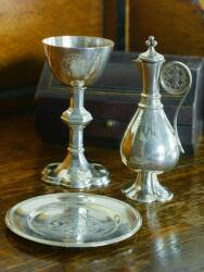 A VICTORIAN SILVER COMMUNION SET